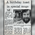 A birthday toast in special mugs